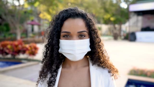 smiling woman behind face protection mask - protective face mask stock videos & royalty-free footage