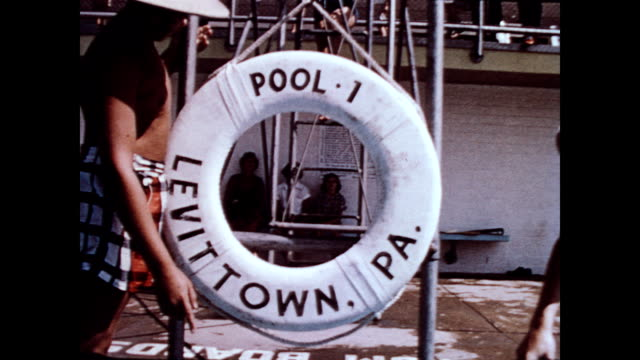 / smiling woman climbs steps to diving board / men walking around pools in the sun / three people dive off three boards simultaneously / man chats... - levittown pennsylvania stock videos and b-roll footage