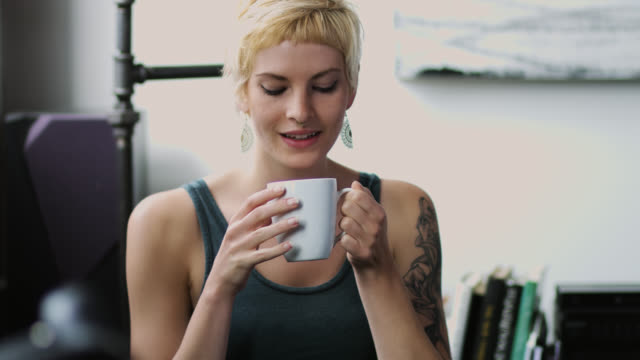 smiling woman drinking coffee - nose ring stock videos & royalty-free footage