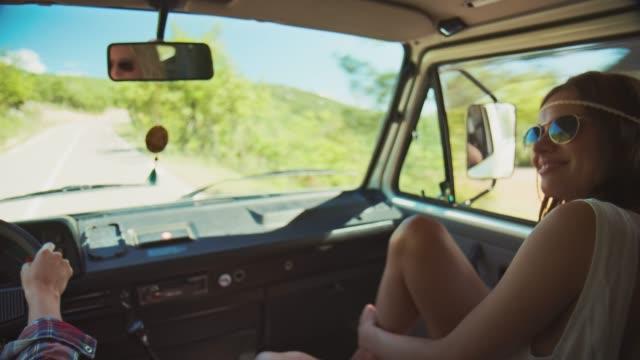 vídeos de stock e filmes b-roll de smiling woman enjoying road trip during summer - viagem em estrada