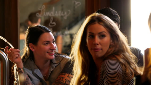 MS Smiling woman hanging out with friends at bar