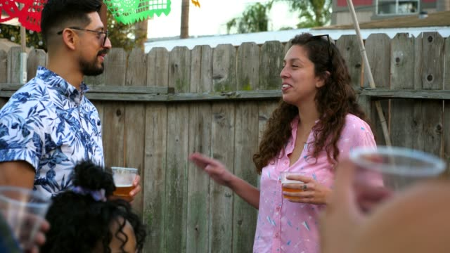 ms smiling woman hanging out with friends during backyard party - 20 29 years stock videos & royalty-free footage