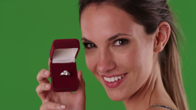 smiling woman holding diamond engagement ring in jewelry box on greenscreen - jewelry box stock videos and b-roll footage