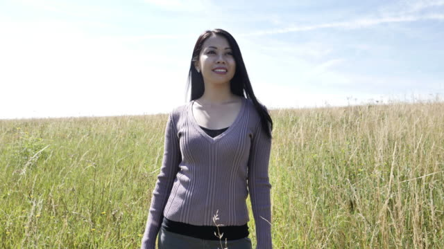 Smiling woman in a meadow.