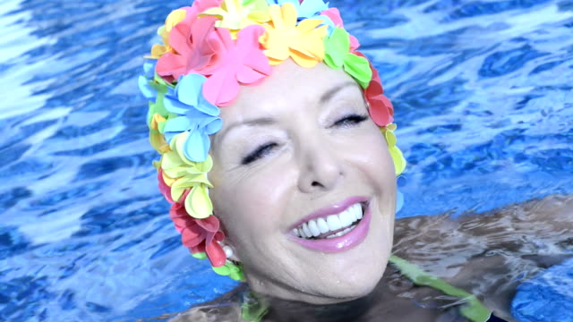 smiling woman in a pool - swimming cap stock videos and b-roll footage
