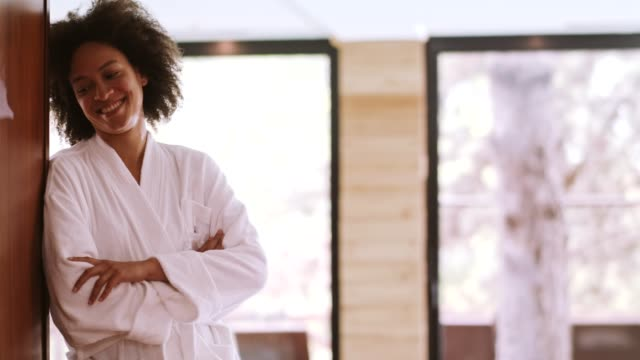smiling woman in bathrobe relaxing at spa - bathrobe stock videos & royalty-free footage