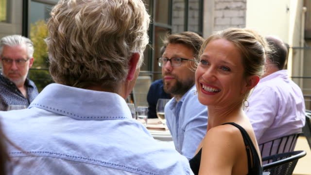 ms smiling woman in discussion with friend during dinner party on summer evening - 50 59 years stock videos & royalty-free footage