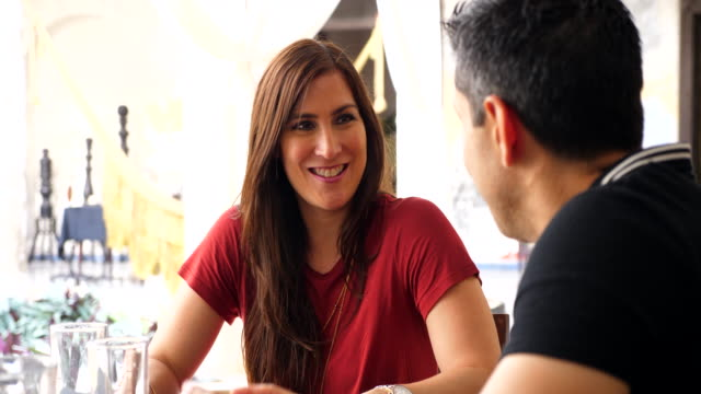 cu smiling woman in discussion with husband while sitting at table in outdoor cafe - married stock videos & royalty-free footage