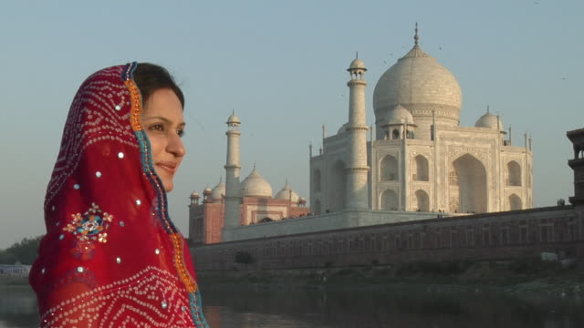 zi, cu, smiling woman looking at view, taj mahal in background, agra, uttar pradesh, india - mughal empire stock videos and b-roll footage