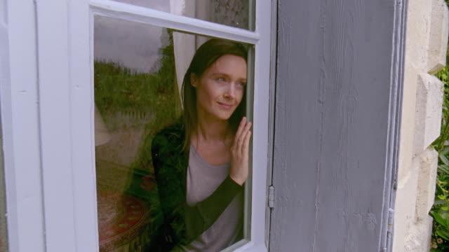 MS, Smiling woman looking through window, Saint Ferme, Gironde, France