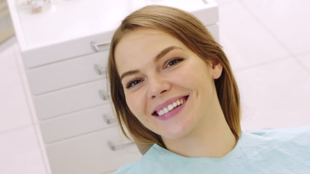 smiling woman on dental exam - dental hygiene stock videos & royalty-free footage