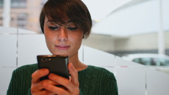 smiling woman texting - bangs stock videos and b-roll footage