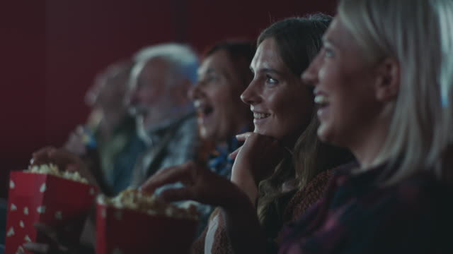 smiling woman watching movie at cinema - cinema stock videos & royalty-free footage