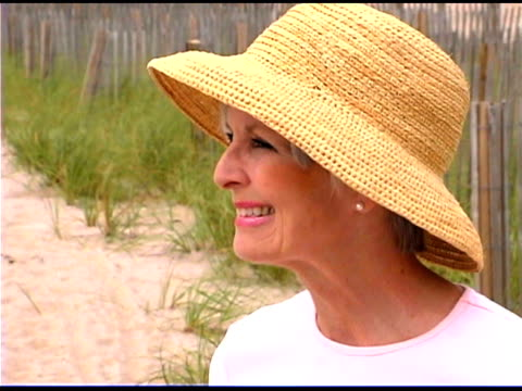 smiling woman wearing straw hat - straw hat stock videos & royalty-free footage