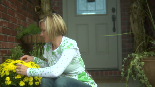 smiling woman with flowers - front porch stock videos and b-roll footage