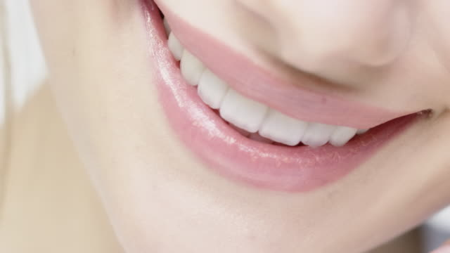 smiling woman with glossy lips and blue eyes - toothy smile stock videos & royalty-free footage