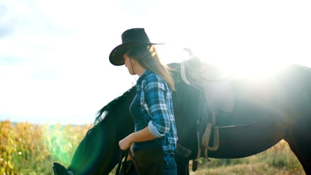 Smiling woman with horse in nature