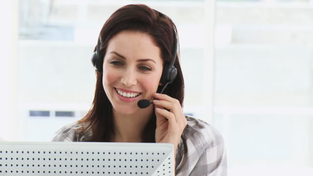 CU Smiling woman working in call center / Cape Town, Western Cape, South Africa