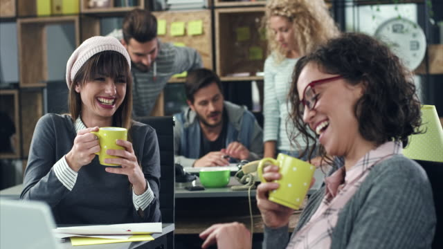 smiling women having coffee break - fare una pausa video stock e b–roll