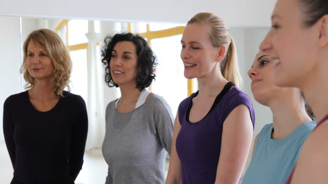 Smiling women listening in health club