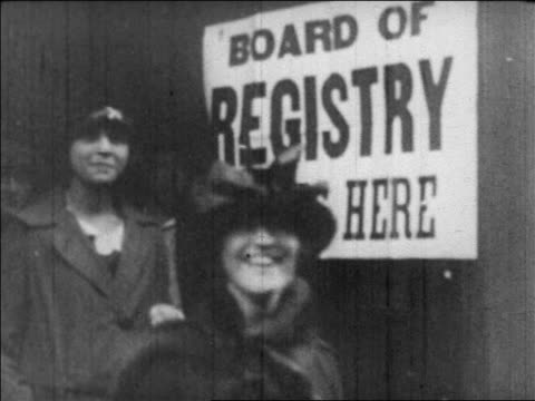 B/W 1920 smiling women walking out of Board of Registry building / newsreel