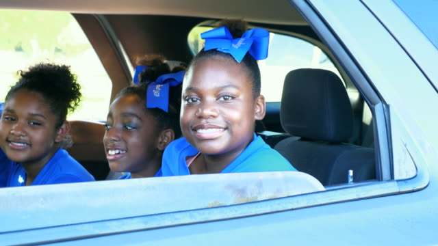 ms zi smiling young cheerleaders sitting together in back seat of car after practice - cheerleader stock videos and b-roll footage