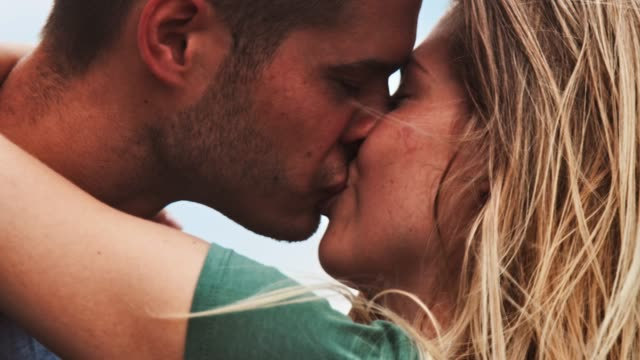 smiling young couple kissing during vacation - romance video stock e b–roll