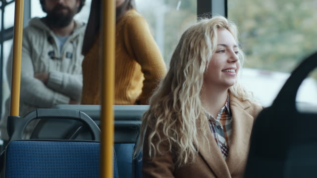 smiling young girl in the bus - bus stock videos & royalty-free footage