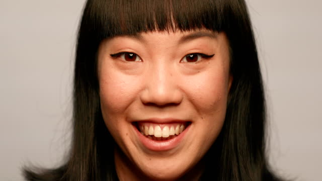 smiling young woman against white background - bangs stock videos and b-roll footage