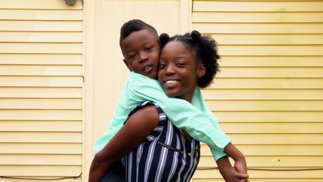 ms smiling young woman carrying younger brother on back - sister stock videos & royalty-free footage
