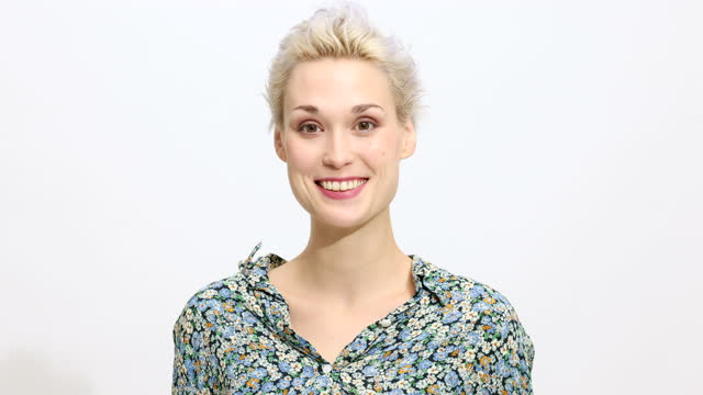 smiling young woman posing on white background - short hair stock videos & royalty-free footage