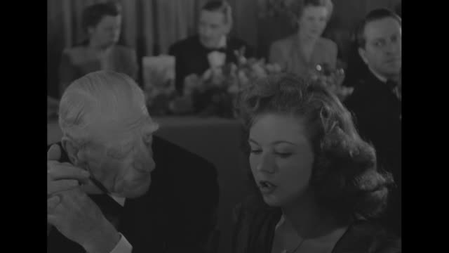 vídeos de stock e filmes b-roll de ms smith and temple seated at table - shirley temple