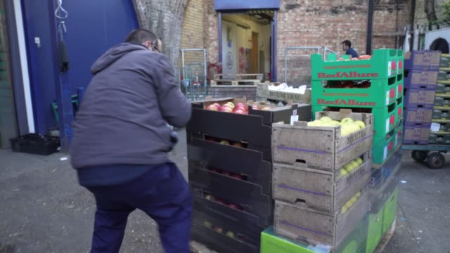 smith brock workers prepare a pallet of food food smith brock who are best known for supplying fresh food to restaurants and hotels in london have... - freshness stock videos & royalty-free footage