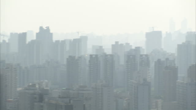 Smog blankets the Shanghai skyline. Available in HD