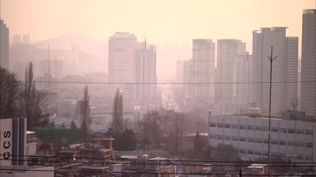 smog covers high-rises in a cityscape of seoul. available in hd. - smog stock videos & royalty-free footage