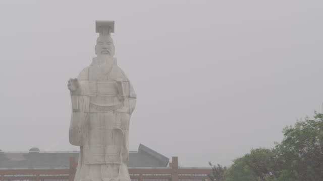 smog covers the emperor of qin's statue in xian, china. - emperor stock videos and b-roll footage