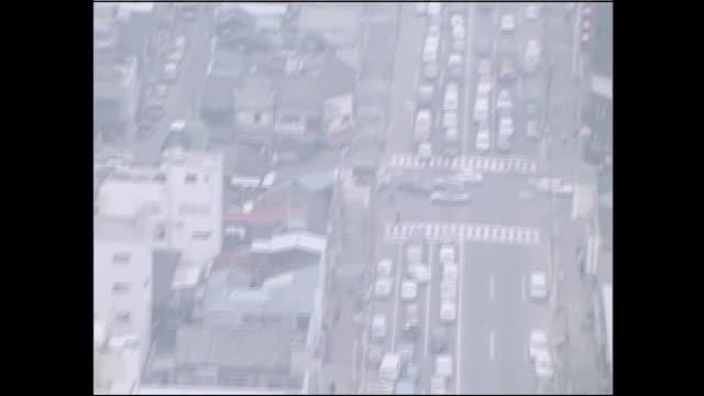 Smog hangs over a congested highway in Tokyo, Japan.