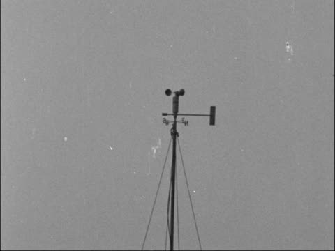 smog in london clears after five days int people queuing at counters general view port/harbour weather vane on mast people along through park boy... - 1962 stock videos and b-roll footage