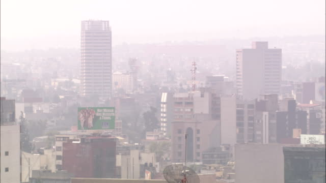 smog shrouds skyscrapers in mexico city. - mexico stock videos & royalty-free footage