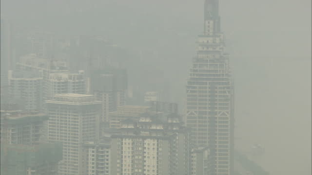 Smog surrounds highrise office buildings in China.