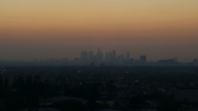 smoggy dawn la hd timelapse - smog stock videos & royalty-free footage