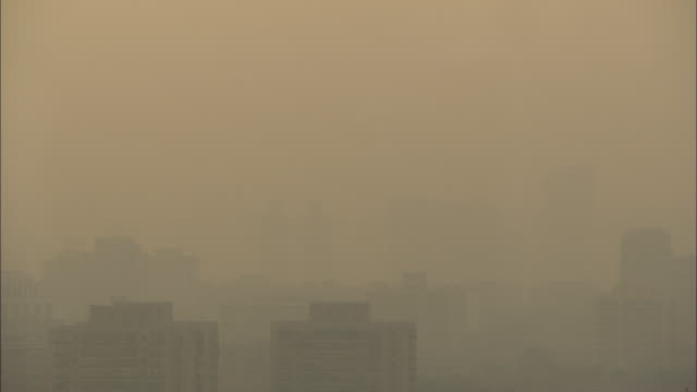 ms ha smoggy sky with silhouette of buildings, guilin, guangxi zhuang autonomous region, china - guangxi zhuang autonomous region china stock videos & royalty-free footage