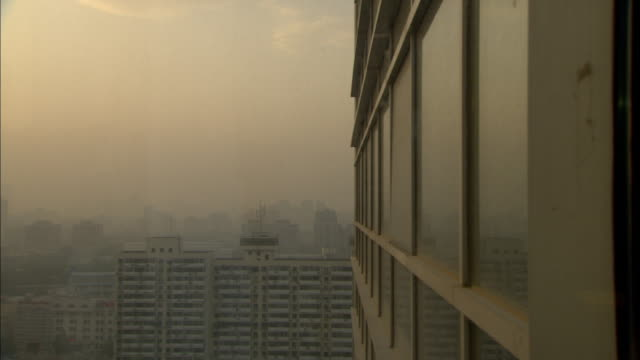 MS HA PAN Smoggy sky with silhouette of buildings, Guilin, Guangxi Zhuang Autonomous Region, China