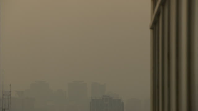 MS HA ZO Smoggy sky with silhouette of buildings, Guilin, Guangxi Zhuang Autonomous Region, China
