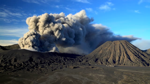 smoke and ash clouds from mount bromo java - eruzione video stock e b–roll