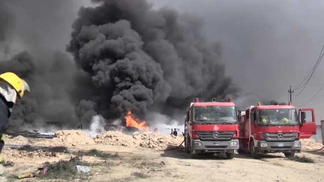 smoke and ash rains downing from around a eleven oil wells that daesh militants set ablaze as iraqi troops moved in to retake qayara on september 01... - ash stock videos & royalty-free footage