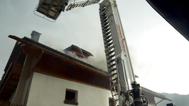 smoke and fire on the roof - fire protection suit stock videos & royalty-free footage