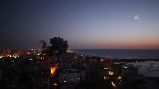 smoke and flame rise after israeli warplanes conducted airstrikes in gaza city, gaza on may 12, 2021. - bomb stock videos & royalty-free footage