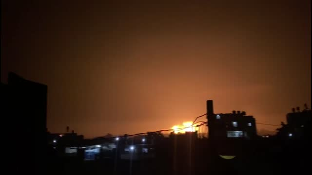 smoke and flames rise after israeli fighter jets conducted airstrikes over beit lahia in the gaza strip, on may 13, 2021. the death toll from israeli... - ガザ地区点の映像素材/bロール