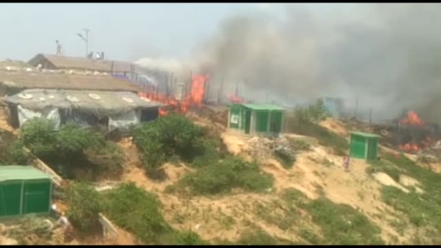 cox's bazar bangladesh april 24 smoke and flames rise from the site of a fire at the kutupalong refugee camp in cox's bazar bangladesh on april 24... - rohingya kultur stock-videos und b-roll-filmmaterial